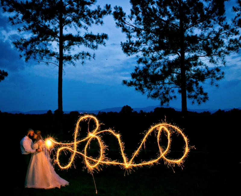 Bride and groom at night with mountain views at Parker-Binns Vineyard in Mill Spring, NC