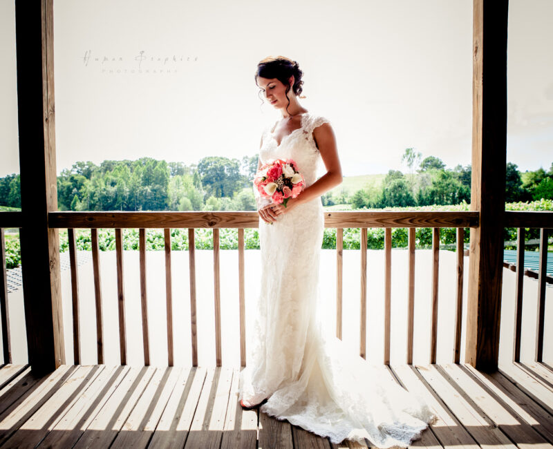 Bride on loft deck with vineyard views at Parker-Binns Vineyard in Mill Spring, NC